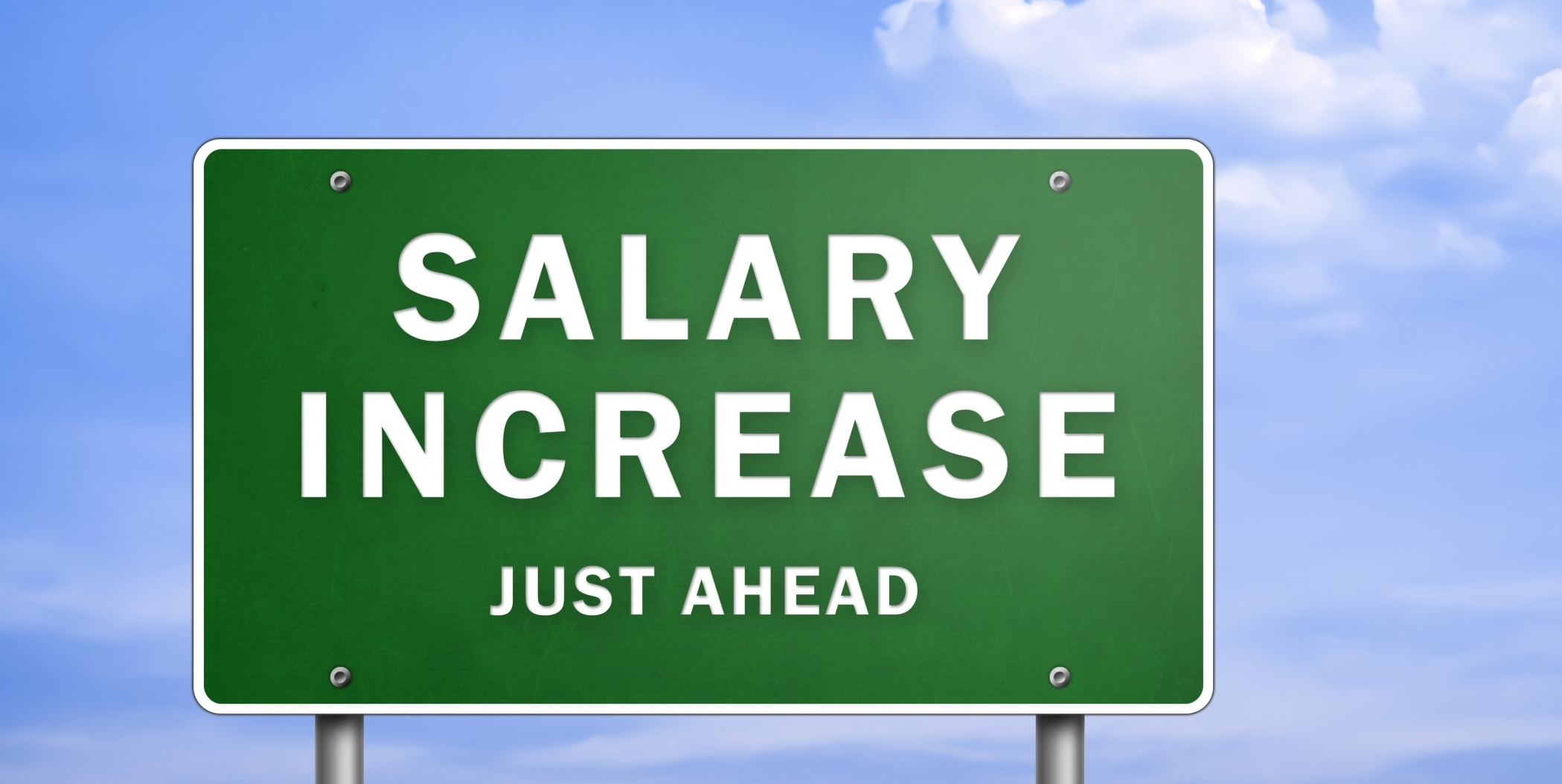 Road sign reading salary increase ahead